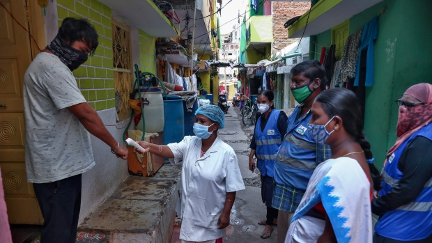 An Indian health worker checks body temperature of a man during a door-to-door survey being conducted as a precaution against COVID-19 in Hyderabad, India, Thursday, May 6, 2021. (AP Photo/Mahesh Kumar A.)