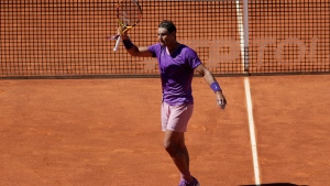 Rafael Nadal of Spain celebrates after defeating Alexei Popyrin of Australia 6-3, 6-3 at the Madrid Open tennis tournament in Madrid, Spain, Thursday, May 6, 2021. (AP Photo/Paul White)