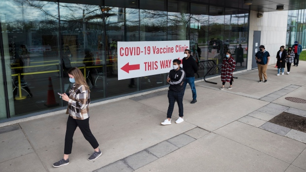 People in Peel region line up outside the University of Toronto Mississauga campus for the COVID-19 vaccination clinic in Mississauga, Ont., on Thursday, May 6, 2020. THE CANADIAN PRESS/Tijana Martin