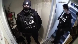 A Hamilton police officer who allegedly lunged at a woman while responding to a reported dispute between a landlord and their tenant is shown in this image taken from a video posted to social media. (Twitter)