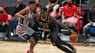 Toronto Raptors forward Pascal Siakam (43) drives around Washington Wizards forward Chandler Hutchison (1) during the first half of an NBA basketball game Thursday, May 6, 2021, in Tampa, Fla. (AP Photo/Chris O'Meara)