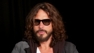 FILE - This Sept. 23, 2011 file photo shows musician Chris Cornell in New York. The family of Chris Cornell and a doctor who they alleged over-prescribed him drugs before he died have agreed to a settle a lawsuit. Documents filed in Los Angeles court by attorneys for the rock singer's widow and their children said a confidential settlement had been reached. The documents were filed in April, but had gone unnoticed before City News Service reported on them Thursday, May 6, 2021. (AP Photo/John Carucci, File)