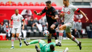 New York Red Bulls attacker Fabio, center, fights for the ball against Toronto FC defender Omar Gonzalez, right, and goalkeeper Alex Bono during an MLS soccer match, Saturday, May 8, 2021, at Red Bull Arena in Harrison, NJ. (AP Photo/Eduardo Munoz Alvarez)