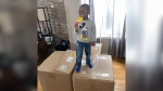 Noah Ruiz enjoys a SpongeBob Popsicle, one of 918 he ordered with his mother's Amazon account. (Courtesy Jennifer Bryant via CNN)