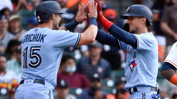 Toronto Blue Jays' Cavan Biggio, right, celebrates his two-run home run with Randal Grichuk during the second inning of the team's baseball game against the Houston Astros, Saturday, May 8, 2021, in Houston. (AP Photo/Eric Christian Smith)