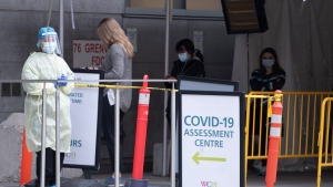 A nurse stands outside the COVID-19 testing centre at Women's College Hospital in Toronto on Friday, April 9, 2021. THE CANADIAN PRESS/Frank Gunn