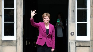 Scotland's First Minister and Scottish National Party leader Nicola Sturgeon poses for photographers, at Bute House in Edinburgh, Scotland. Sunday, May 9, 2021. British Prime Minister Boris Johnson has invited the leaders of the U.K.'s devolved nations for crisis talks on the union after Scotland's pro-independence party won its fourth straight parliamentary election. (AP Photo/Scott Heppell)