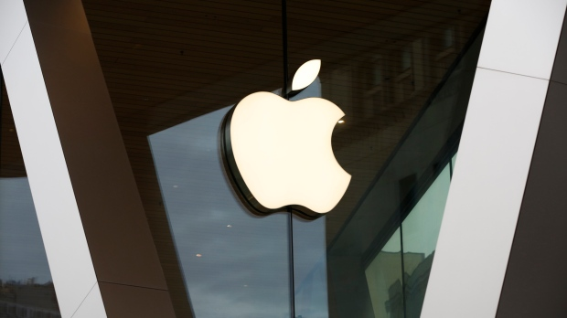 FILE - In this Saturday, March 14, 2020 file photo, an Apple logo adorns the facade of the downtown Brooklyn Apple store in New York. If Epic Games hopes to dismantle the fortress surrounding Apple's iPhone and its app store, the video game maker probably will need to roll out some heavier artillery heading into the second week of a trial threatening Apple's $2 trillion empire. (AP Photo/Kathy Willens, File)