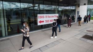 People in Peel region line up outside the University of Toronto Mississauga campus for the COVID-19 vaccination clinic in Mississauga, Ont., on Thursday, May 6, 2021. THE CANADIAN PRESS/Tijana Martin