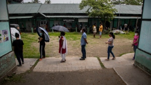Indians aged above eighteen years queue up to get vaccinated against the coronavirus in Gauhati, Assam, India, Monday, May 10, 2021. (AP Photo/Anupam Nath)