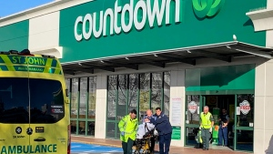 First responders take a victim to an ambulance outside a Countdown supermarket in central Dunedin, New Zealand, Monday May 10, 2021. A man began stabbing people at the supermarket Monday, wounding five people, three of them critically, according to authorities. (NZME via AP)
