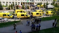 In this image taken from video, an ambulance and police trucks are parked at a school after a shooting, in Kazan, Russia, Tuesday, May 11, 2021. Russian media report that several people have been killed and wounded in a school shooting in the city of Kazan. Russia's state RIA Novosti news agency reported the shooting took place Tuesday morning, citing emergency services. (AP Photo)