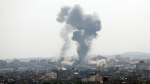 Smoke rises after an Israeli forces strike in Gaza, Tuesday, May 11, 2021. (AP Photo/Hatem Moussa)