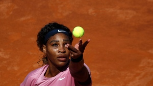 Serena Williams of the United States serves the ball to Nadia Podoroska of Argentina during their match at the Italian Open tennis tournament, in Rome, Wednesday, May 12, 2021. (AP Photo/Alessandra Tarantino)