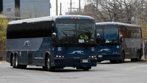A Greyhound bus is driven out of the bus terminal in Ottawa Thursday May 7, 2020 in Ottawa. Greyhound Canada is permanently cutting all bus routes across the country, shutting down the intercity bus carrier's operations in Canada after nearly a century of service. THE CANADIAN PRESS/Adrian Wyld