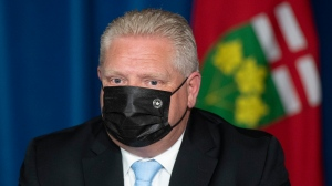 """Ontario Premier Doug Ford listens to a question during a press conference at the Ontario Legislature in Toronto, Thursday, May 13, 2021. Ontario is extending its stay-at-home order until June 2 to bring down high rates of COVID-19, a move Premier Doug Ford said was necessary to bring infection cases down and """"save the summer."""" THE CANADIAN PRESS/Frank Gunn"""
