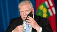 "Ontario Premier Doug Ford reacts to a question during a press conference at the Ontario Legislature in Toronto, Thursday, May 13, 2021. Ontario is extending its stay-at-home order until June 2 to bring down high rates of COVID-19, a move Premier Doug Ford said was necessary to bring infection cases down and ""save the summer."" THE CANADIAN PRESS/Frank Gunn"