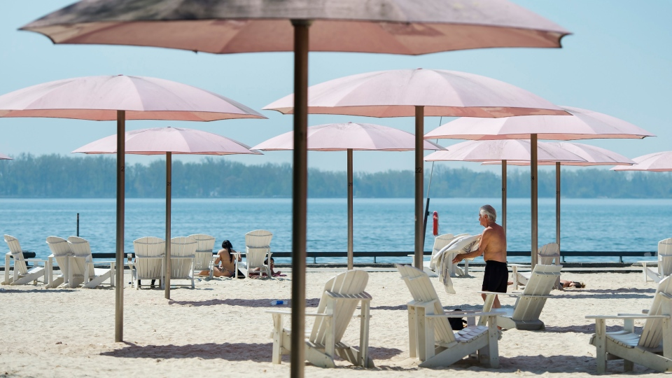 People practice physical distancing as they enjoy the hot weather at Sugar Beach during the COVID-19 pandemic in Toronto on Tuesday, May 26, 2020. THE CANADIAN PRESS/Nathan Denette