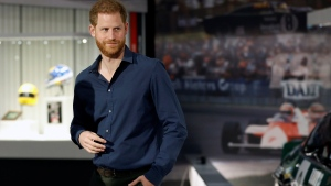 "FILE - In this Friday March 6, 2020, file photo, Britain's Prince Harry visits the Silverstone Circuit, in Towcester, England. In an episode of the ""Armchair Expert"" podcast broadcast Thursday, May 13, 2021, Prince Harry compared his royal experience to being on ""The Truman Show"" and ""living in a zoo."" (Peter Nicholls/Pool Photo via AP, File)"