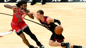 Toronto Raptors guard Malachi Flynn, right, drives against Chicago Bulls guard Coby White during the first half of an NBA basketball game in Chicago, Thursday, May 13, 2021. (AP Photo/Nam Y. Huh)
