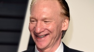 "FILE - In this Sunday, Feb. 26, 2017, file photo, Bill Maher arrives at the Vanity Fair Oscar Party in Beverly Hills, Calif. A taping of Maher's weekly HBO show was cancelled after the host tested positive for COVID. Maher, who is fully vaccinated, is ""asymptomatic and feels fine,"" according to a statement Thursday, May 13, 2021, from HBO. (Photo by Evan Agostini/Invision/AP, File)"