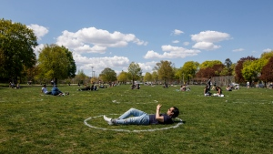 People use social distancing circles at Trinity-Bellwoods park in Toronto, Thursday, May 13, 2021. THE CANADIAN PRESS/Cole Burston