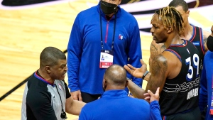 Philadelphia 76ers center Dwight Howard (39) talks with official Tony Brothers, left, after an altercation with Miami Heat forward Udonis Haslem during the first half of an NBA basketball game Thursday, May 13, 2021, in Miami. (AP Photo/Lynne Sladky)