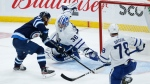 Winnipeg Jets' Kyle Connor (81) scores on Toronto Maple Leafs goaltender Jack Campbell (36) as TJ Brodie (78) defends during second period NHL action in Winnipeg on Friday, May 14, 2021. THE CANADIAN PRESS/John Woods