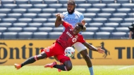 New York FC defender Sebastien Ibeaha, back, fights for the ball against Toronto FC defender Richie Laryea during an MLS soccer match at Yankee Stadium, Saturday, May 15, 2021. in New York. (AP Photo/Eduardo Munoz Alvarez)