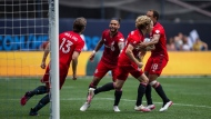 Toronto FC players celebrate their goal against New York FC during an MLS soccer match at Yankee Stadium on, Saturday, May15, 2021. in New York. (AP Photo/Eduardo Munoz Alvarez)