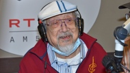 "In this photo provided by Radio Television Hong Kong (RTHK), 96-year-old DJ, Ray Cordeiro, also know as Uncle Ray, finishes his last show ""All The Way with Ray"" at the studio in RTHK, the broadcaster in Hong Kong on Feb. 15, 2021. After more than seven decades in radio, the 96-year-old Hong Kong DJ bid farewell to his listeners Saturday, May 15, 2021 with ""Time to Say Goodbye,"" sung by Sarah Brightman and Andrea Bocelli. (Radio Television Hong Kong via AP)"