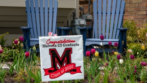 A sign celebrating a high school graduate is planted in the lawn at a home in Toronto on Sunday, May 17, 2020. THE CANADIAN PRESS/Frank Gunn