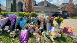 A memorial grows outside a home where two young siblings died following a crash in Vaughan on Sunday. (Ken Enlow/CP24)