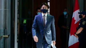 Prime Minister Justin Trudeau makes his way to hold a press conference in Ottawa on Tuesday, May 18, 2021. THE CANADIAN PRESS/Sean Kilpatrick