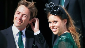 """In this Aug. 31, 2019 file photo, Princess Beatrice and her then fiance Edoardo Mapelli Mozzi attend the wedding of Ellie Goulding and Caspar Jopling, in York, England. Buckinghan Palace said Wednesday, May 19, 2021 that the 32-year-old granddaughter of Queen Elizabeth II and husband Edoardo Mapelli Mozzi are due to have their first child in the autumn. It said """"both families are delighted with the news."""" Beatrice, who is the elder daughter of Prince Andrew and the former Sarah Ferguson, married property developer Mapello Mozzi in July 2020, at a small ceremony constrained by coronavirus restrictions. (Peter Byrne/PA via AP, File)"""