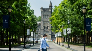 A person walks past the University of Toronto campus during the COVID-19 pandemic in Toronto on Wednesday, June 10, 2020. THE CANADIAN PRESS/Nathan Denette