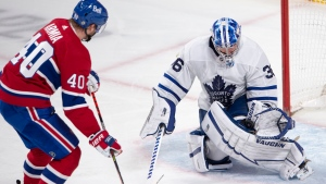 Toronto Maple Leafs goaltender Jack Campbell (36) stops Montreal Canadiens' Joel Armia (40) on a breakaway during second period NHL hockey action Wednesday, April 28, 2021 in Montreal. THE CANADIAN PRESS/Ryan Remiorz