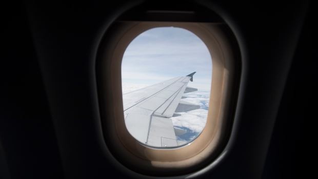 The view out the window during a flight from Vancouver to Calgary, Tuesday, June 9, 2020. Airlines in Canada and around the world are suffering financially due to the lack of travel and travel bans due to COVID-19. THE CANADIAN PRESS/Jonathan Hayward