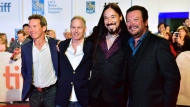 """The Tragically Hip, from left, Gord Sinclair, Johnny Fay, Rob Baker and Paul Langlois arrive on the red carpet for the movie """"Long Time Running"""" during the 2017 Toronto International Film Festival in Toronto on Wednesday, September 13, 2017. THE CANADIAN PRESS/Frank Gunn"""