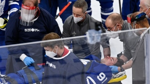 Toronto Maple Leafs forward John Tavares (91) is helped on to a stretcher after being injured against the Montreal Canadiens during first period NHL Stanley Cup playoff action in Toronto on Thursday, May 20, 2021. THE CANADIAN PRESS/Frank Gunn