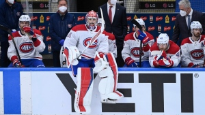 Montreal Canadiens goaltender Carey Price (31) watches from the bench as the Toronto Maple Leafs score an empty net goal during third period NHL Stanley Cup playoff hockey action in Toronto on Saturday, May 22, 2021. THE CANADIAN PRESS/Nathan Denette