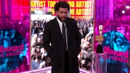 In this video image provided by NBC, The Weeknd accepts the top hot 100 artist award during the Billboard Music Awards on Sunday, May 23, 2021. (NBC via AP)