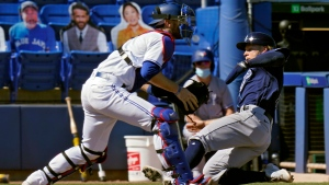 Tampa Bay Rays' Taylor Walls, right, scores in front of Toronto Blue Jays catcher Danny Jansen (9) on a two-run single by Francisco Mejia during the 11th inning of a baseball game Monday, May 24, 2021, in Dunedin, Fla. (AP Photo/Chris O'Meara)