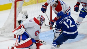 Montreal Canadiens goaltender Carey Price (31) makes a save on Toronto Maple Leafs forward Alex Galchenyuk (12) as Canadiens defenceman Ben Chiarot (8) defends during first period NHL Stanley Cup playoff hockey action in Toronto on Saturday, May 22, 2021. THE CANADIAN PRESS/Nathan Denette