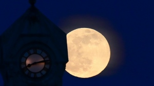 The Super Pink Full Moon rises over the former Almonte post office, which is a National Historic Site of Canada, in Mississippi Mill, Ont., on Monday, April 26, 2021. THE CANADIAN PRESS/Sean Kilpatrick