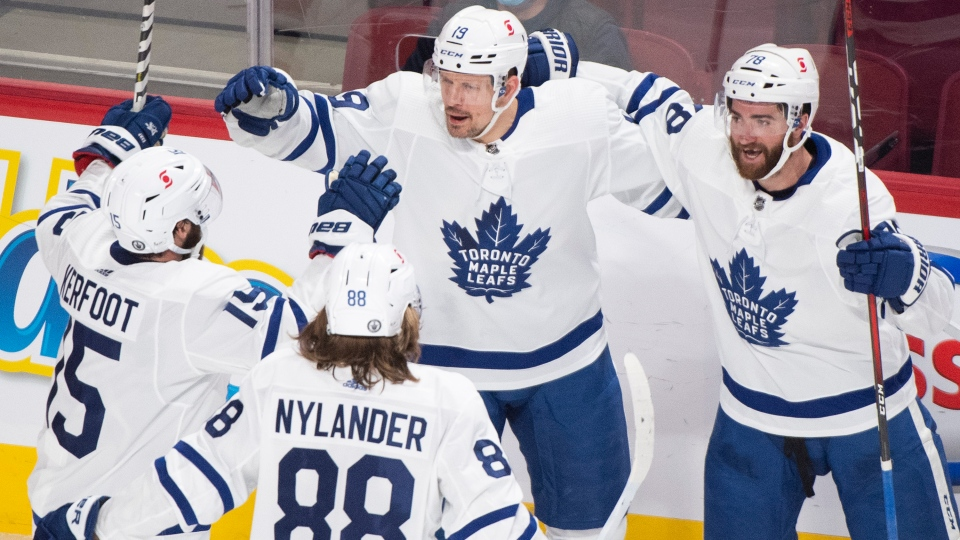 Toronto Maple Leafs' Jason Spezza (19) celebrates with teammates after scoring against the Montreal Canadiens during third period NHL Stanley Cup playoff hockey action in Montreal, Saturday, May 29, 2021. THE CANADIAN PRESS/Graham Hughes