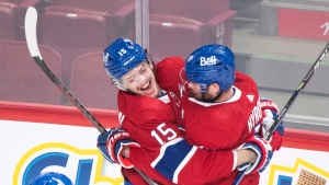 Montreal Canadiens' Jesperi Kotkaniemi (15) celebrates with teammate Paul Byron after scoring against the Toronto Maple Leafs during overtime period NHL Stanley Cup playoff hockey action in Montreal, Saturday, May 29, 2021. THE CANADIAN PRESS/Graham Hughes