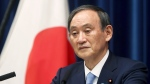 In this May 28, 2021, file photo, Japan's Prime Minister Yoshihide Suga speaks during a news conference at the prime minister's official residence in Tokyo. (Behrouz Mehri/Pool Photo via AP, File)