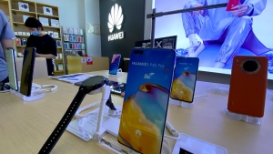 Huawei devices are displayed in a Huawei store in Beijing on Wednesday, June 2, 2021. (AP Photo/Ng Han Guan)