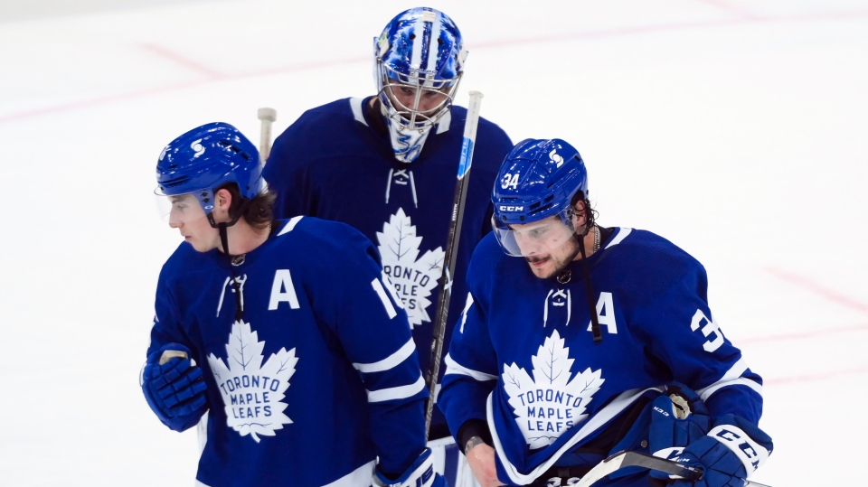 Toronto Maple Leafs forward Auston Matthews (34) and teammates Mitchell Marner (16) and Jack Campbell (36) skate off in dejection at the end of third period NHL Stanley Cup hockey action against the Montreal Canadiens, in Toronto, Monday, May 31, 2021. The Canadiens saw the Leafs out of contention for the Cup 3-1 after a seven game series. THE CANADIAN PRESS/Nathan Denette